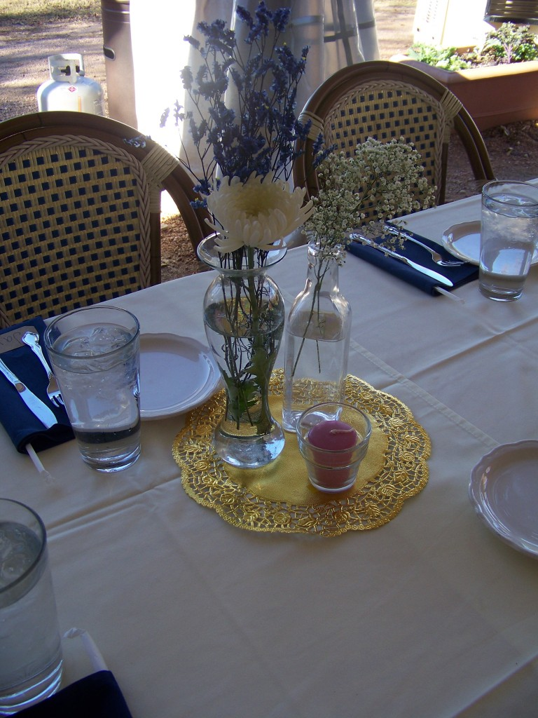 various vases inexpensive flowers doilies budget table